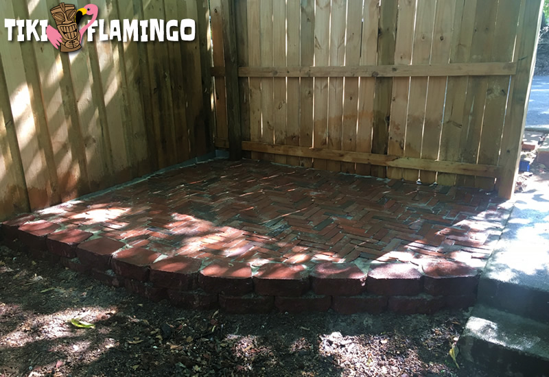 This beautiful patio made of recycled brick will add lots of value to the property but only cost about $30 and 2 days of work to make.