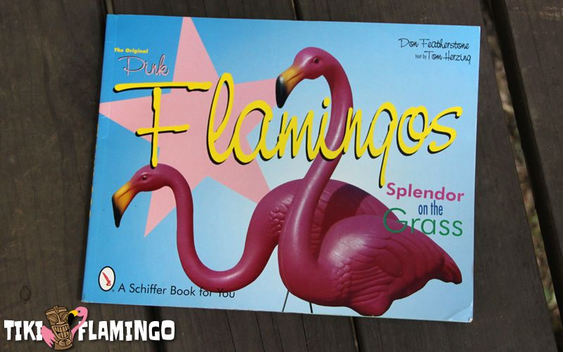 "The book ""The Original Pink Flamingos: Splendor on the Grass"" by Don Featherstone and Tom Herzing."