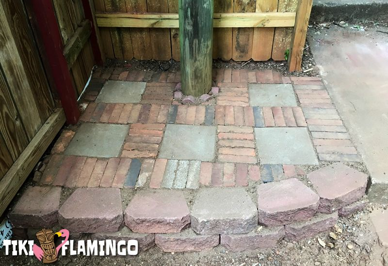 A tiny side patio made completely out of salvaged brick and paving stones.