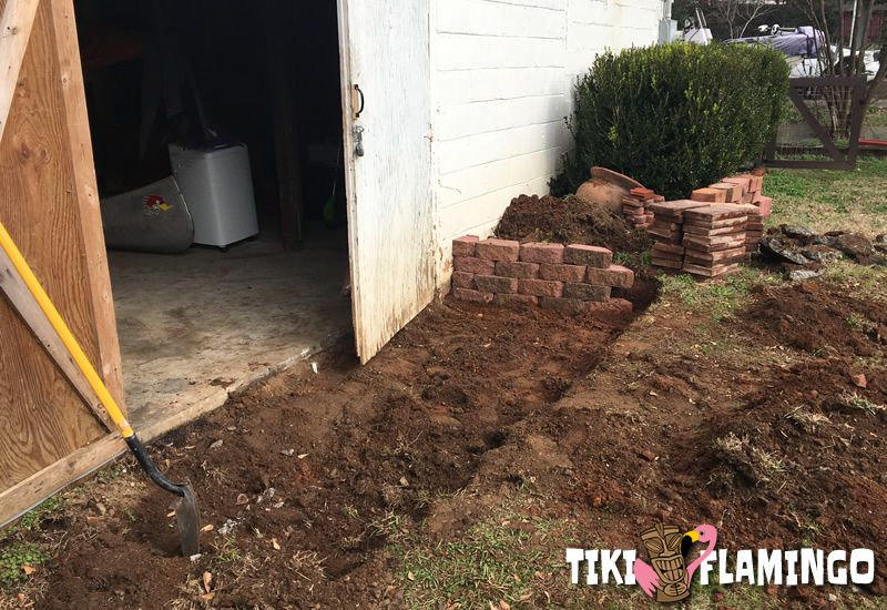 Creating a small DIY patio in front of a basement art studio and workshop.