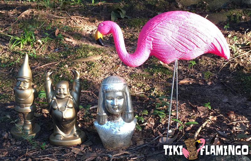 A plastic pink flamingo in a fun yard display in Athens, GA.