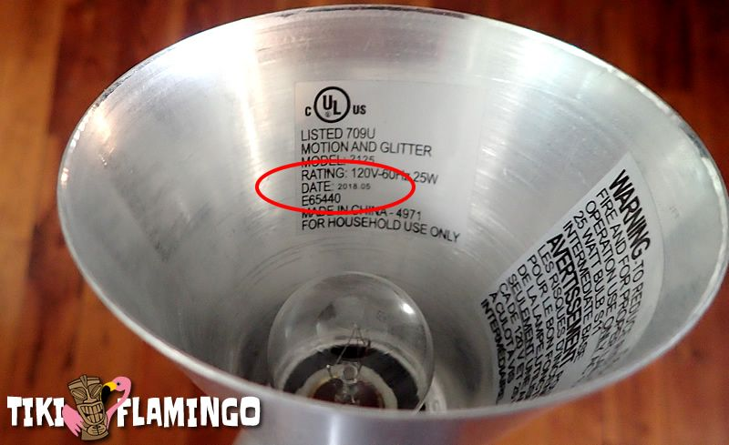The manufacture date on the sticker found on the inside of the base of a lava lamp.